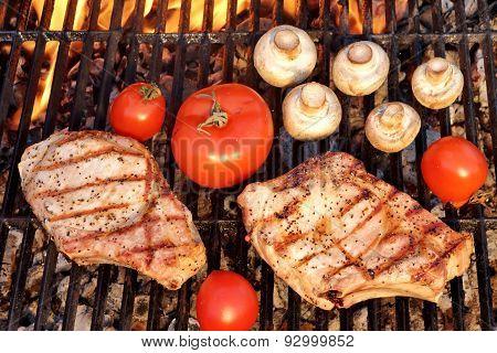 Pork Rib Steak, Tomato And Mushrooms On Hot Bbq Grill