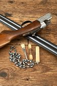 foto of hunt-shotgun  - hunting gun with cleaning kit on a wooden table - JPG