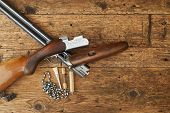 picture of hunt-shotgun  - hunting gun with cleaning kit on a wooden table - JPG