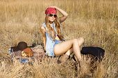 picture of tallgrass  - Hippie girl ready to have picnic on a meadow - JPG