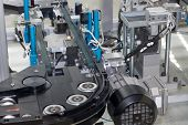 picture of assembly line  - Detailed view of an empty assembly line for the production of plastic components - JPG