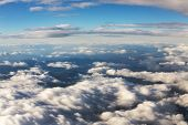 stock photo of puffy  - Blue sky and puffy clouds on height of 5000 m - JPG