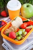 stock photo of sandwich  - Lunch box for kids with sandwich cookies fresh veggies and fruits - JPG