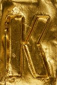 stock photo of letter k  - Beautiful handmade letter K on a shiny gold texture - JPG