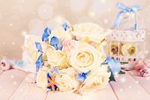 picture of wedding table decor  - Beautiful wedding bouquet with sea decor on wooden table - JPG