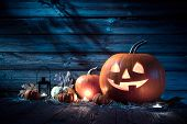 pic of halloween  - Halloween pumpkin head jack lantern on wooden background - JPG