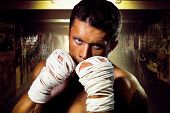 image of underpass  - Street fighter muscular rack attack wrapped in his arms with ropes - JPG