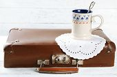 picture of old suitcase  - Old wooden suitcase cap cup with  tea on it - JPG