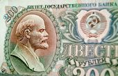 stock photo of lenin  - Detail of an historic Soviet Union banknote for two hundred ruble showing a profile of the Communist leader Lenin - JPG
