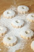 stock photo of sprinkling  - Italian canestrelli biscuits sprinkled with powdered sugar on its surface - JPG