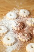 stock photo of sprinkling  - Italian canestrelli biscuits sprinkled with powdered sugar and cocoa - JPG
