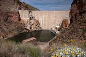 stock photo of dam  - The Theodore Roosevelt Dam is a dam on the Salt River and Tonto Creek located northeast of Phoenix Arizona USA - JPG