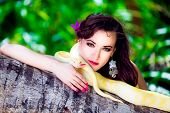 image of jungle snake  - portrait of the beatiful girl with dangerous snake in the tropical jungle - JPG
