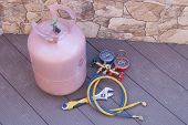 picture of air pressure gauge  - bottle with Freon and tools for refueling of air conditioners - JPG