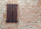 picture of quaint  - Quaint shutters protect the windows of an ancient French building - JPG