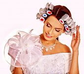 foto of hair curlers  - Woman with hair curlers on head wear in wedding dress on isolated - JPG