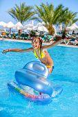 pic of mattress  - Little girl swimming on inflatable beach mattress - JPG