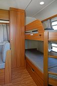stock photo of bunk-bed  - Bunk Bed And Closet in Camping Trailer - JPG