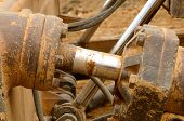 foto of hydraulics  - Detail of a tilt hydraulic cylinder of a large bulldozer construction tractor - JPG