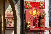 foto of altar  - Small buddhist altar on the streets of Penang - JPG