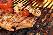 stock photo of rib eye steak  - BBQ Pork Rib Pepper Steak Tomato And Mushrooms On The Hot Flaming Charcoal Grill - JPG