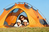image of family fun  - Happy family camping in the mountains - JPG