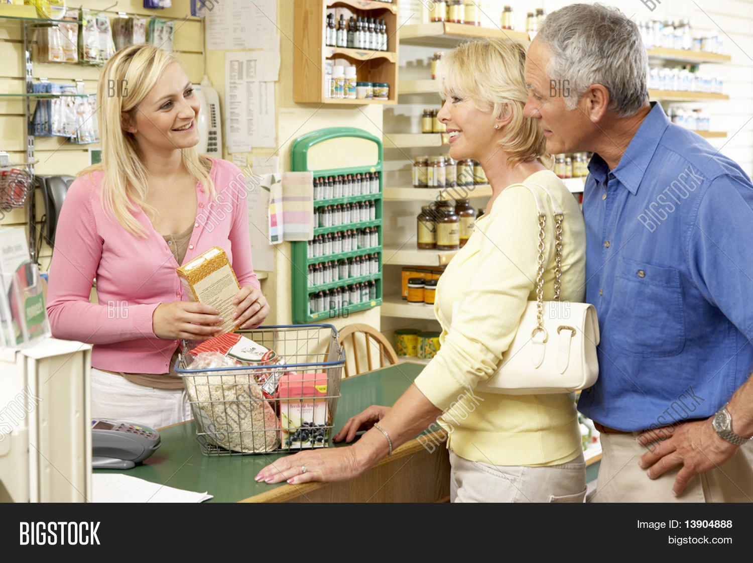 Female sales assistant in health food store stock photo for Assistant cuisine