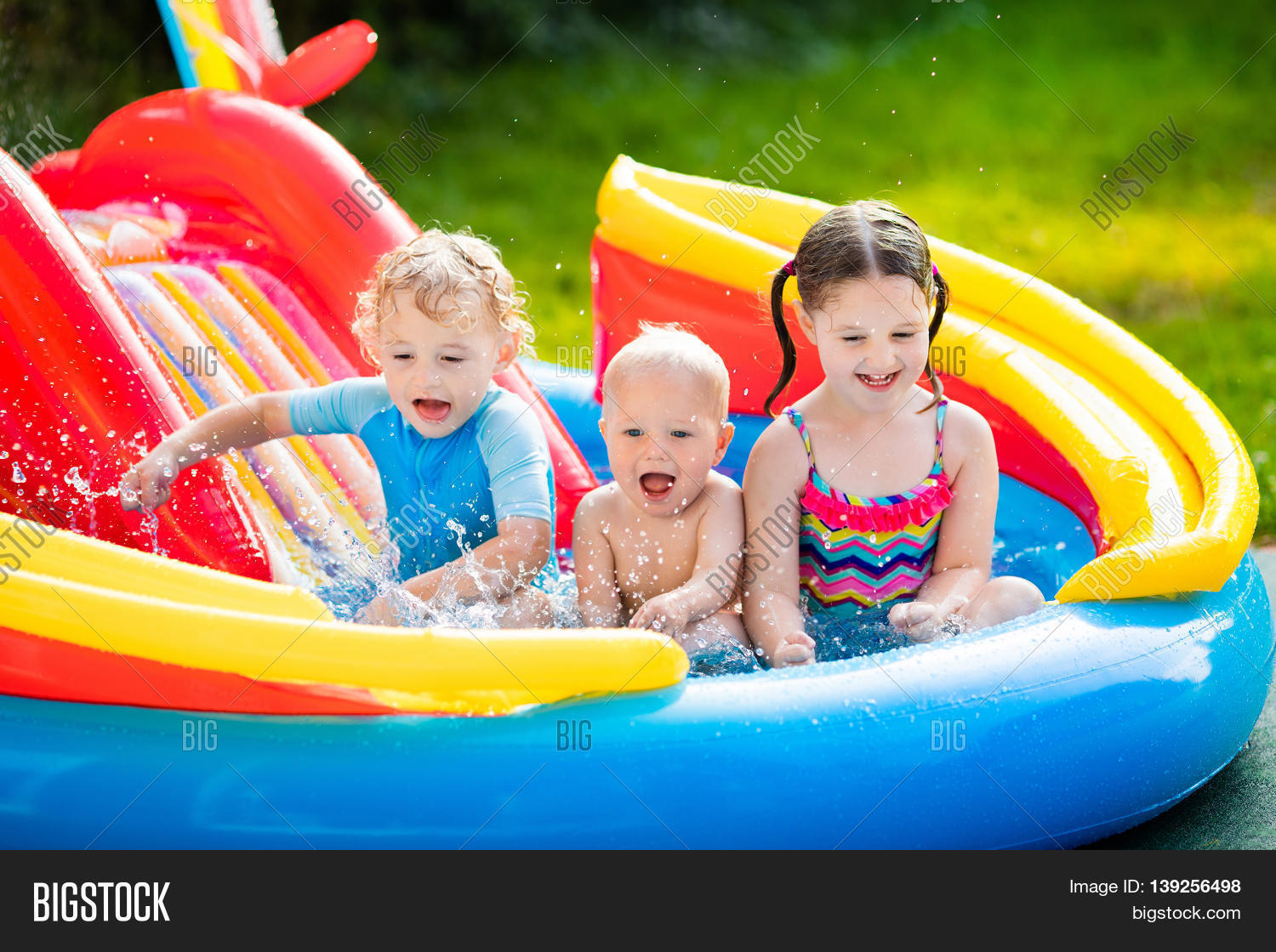 Children playing inflatable baby image photo bigstock for Children s garden pools