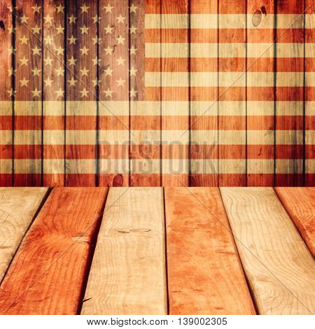 Empty wooden deck table over USA flag background. Independence day 4th of July background. Ready for product display montage.