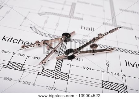 Construction of the building layout, building drawing on paper, a set of compasses for drawing of steel.
