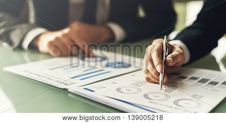 Business Colleague Discussing Paperwork Graphs Concept