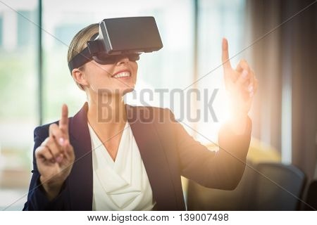 Businesswoman using the virtual reality headset in the office