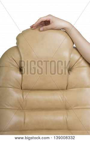 Female Hand Touching New Leather Office Boss Chair (armchair). Furniture Restoration and Replacing update the Material. Work dermatin chair light background. New Stylish Office Furniture