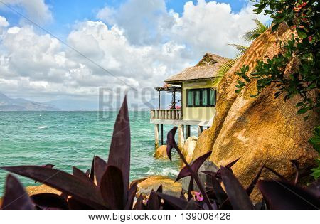 Thatched roof bungalow on island with a house located on bay floor where resort rocky honeymoon for newly married couple, beautiful and idyllic