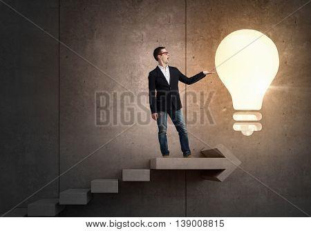 Guy presenting bright idea . Mixed media
