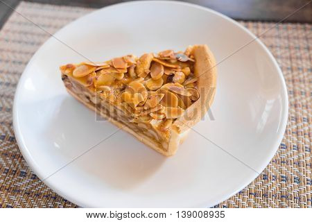 A Slice Of Almonds Pie, On A Plate And Ready To Eat