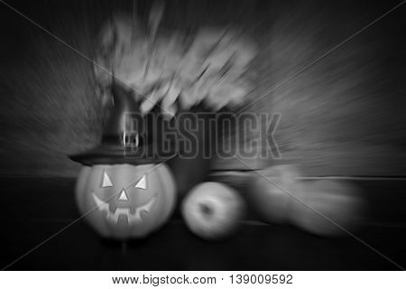 halloween set de-focused and zoom blur of pumpkin doll and apple on wooden background black vignette black and white tone