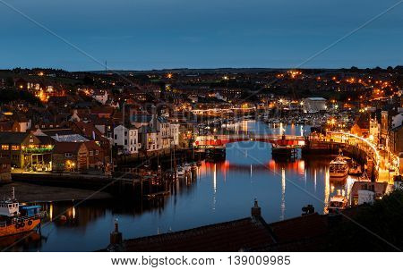 WHITBY ENGLAND - JULY 16: The swing bridge within Whitby harbour at night. In Whitby North Yorkshire England. On 16th July 2016.