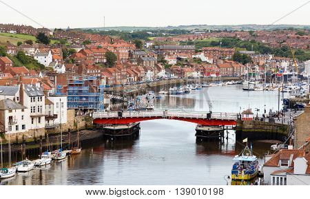 WHITBY ENGLAND - JULY 16: The swing bridge within Whitby harbour. In Whitby North Yorkshire England. On 16th July 2016.