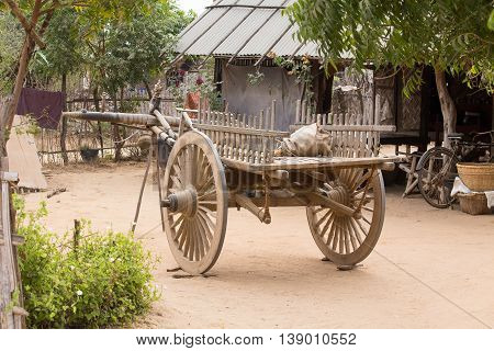 Empty yard with wooden cart. Bagan Myanmar. Burma