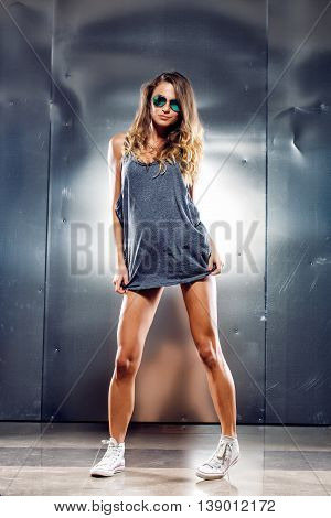 Very sexy girl in a fashion clothes and eyeglasses