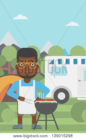 An african-american man cooking meat on barbecue on the background of camper van. Man travelling by camper van and having barbecue party. Vector flat design illustration. Vertical layout.
