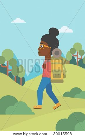 An african-american woman hiking in mountains. Female traveler with backpack mountaineering. Hiking woman with backpack walking outdoor. Vector flat design illustration. Vertical layout.
