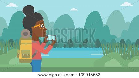 An african-american woman taking photo of landscape with mountains. Young hiking woman with backpack taking photo with her cellphone. Vector flat design illustration. Horizontal layout.