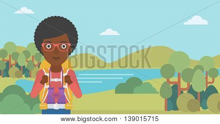 An african-american woman with backpack walking in the mountains. Female backpacker with binoculars. Female traveler hiking in mountains. Vector flat design illustration. Horizontal layout.