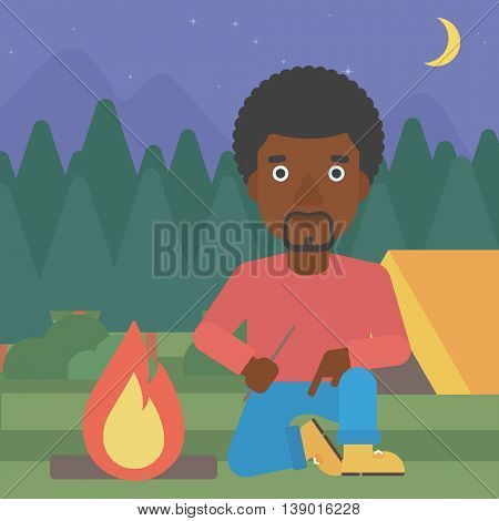 An african-american man kindling a campfire on the background of camping site with tent. Tourist relaxing near campfire. Vector flat design illustration. Square layout.