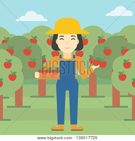 An asian female farmer holding a box with apples in one hand and an apple in another on a background of garden with trees. Farmer collecting apples. Vector flat design illustration. Square layout.