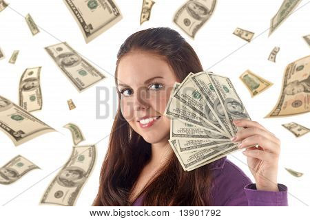Portrait Of Young Businesswoman With Money On Dollars Background