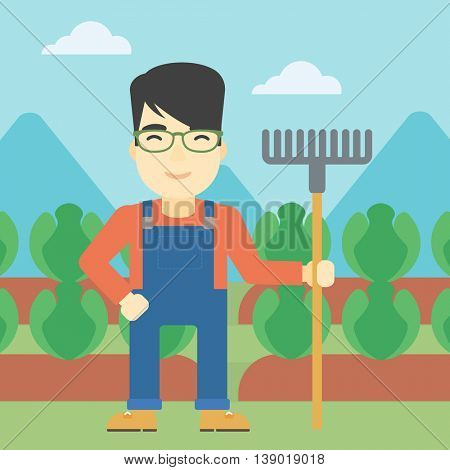 An asian friendly farmer holding a rake. Farmer standing on the background of cabbage field. Vector flat design illustration. Square layout.