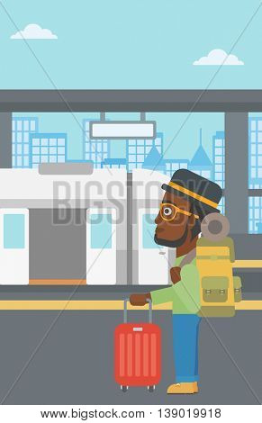 An african-american young man standing at the train station on the background of train with open doors. Young man with suitcase waiting for a train. Vector flat design illustration. Vertical layout.